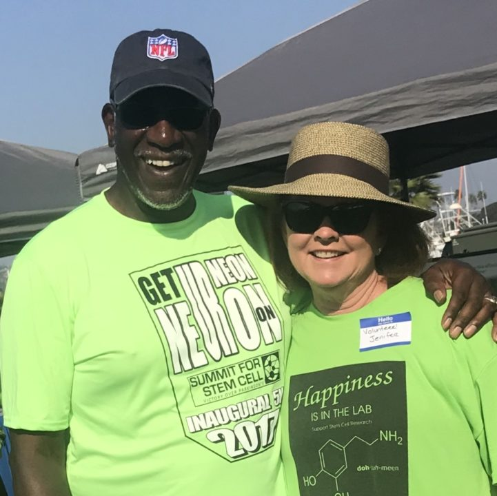 Jenifer at the Summit 5K 2017 with the event's emcee, NFL Hall of Fame cornerback Willie Buchanon